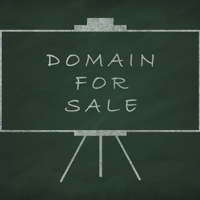 Domain for sale writed on blackboard with chalk